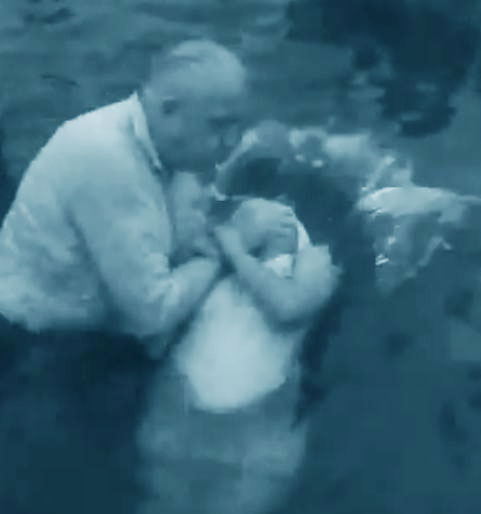 Very young girl baptized in 1946 at Lake Erie