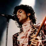 Prince performing [public domain]